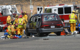 Orange City and Orange County Fire Authority firefighters and paramedics treat at least nine people at scene of major accident at Santiago Canyon Road and Jamboree Road in Orange, Monday afternoon.